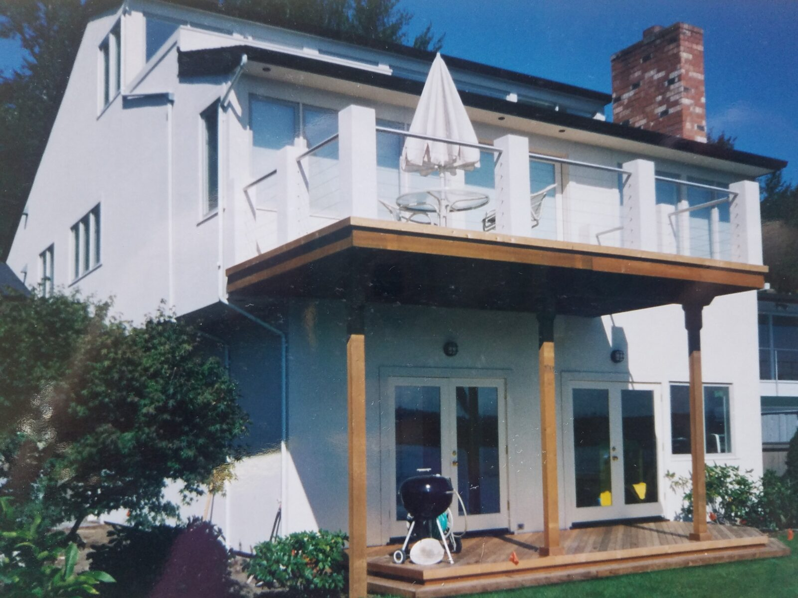 White house with deck and patio