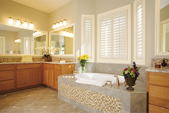 Bathroom with large tub and vanity