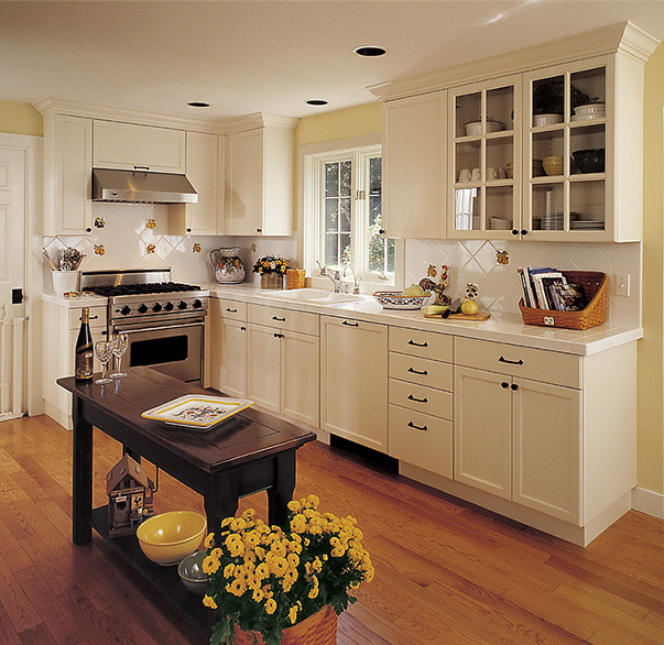 Kitchen with small wood island