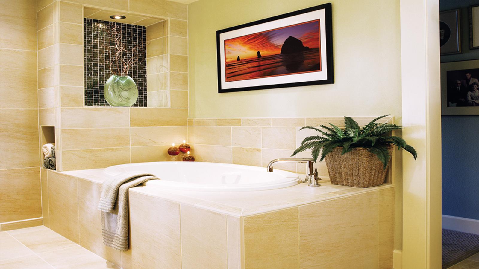 Cream bathroom with large white tub